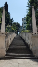 Our journey started on bicycles, riding past a grand staircase with obelisks designed by Palladio and on through farmland making our way to Villa La Rotonda.